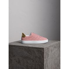 Smooth leather trainers designed with a perforated check pattern and metallic gold detailing at the heel. A cushioned ankle cuff and tongue ensures a comfortable stride. Wear with a lace dress for off-duty days.