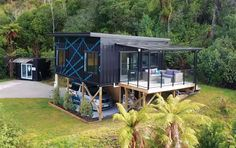 A small house in New Zealand made from three shipping containers.