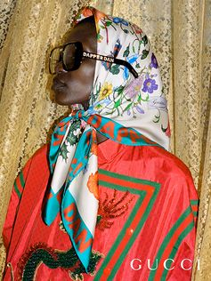 Dapper Dan,' the name of the Harlem-based designer appears on silk printed scarf and square-shaped sunglasses from the Gucci-Dapper Dan collection.