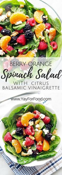 A fresh summer raspberry blackberry spinach salad that's delicious and healthy! Dress this salad with a homemade citrus balsamic vinaigrette! vegetarian | gluten-free