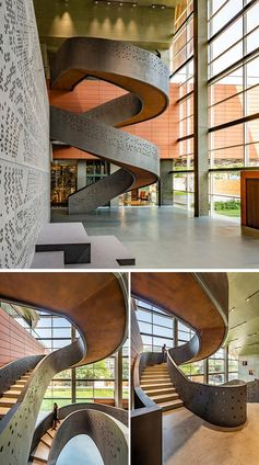 This modern workplace showcases a perforated pattern on the spiral staircase that connects all three levels of the office. The grey exterior of the stairs, with its scattered circle pattern, is reciprocated on the interior of the stairs, allow people to enjoy the pattern while they travel between the levels. #SpiralStairs #Workplace #OfficeDesign #PerforatedPattern