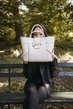 Playing peekaboo with Fei Fei Sun and the #TodsDoubleT: enjoy the #CiaoByTods mood at www.tods.com