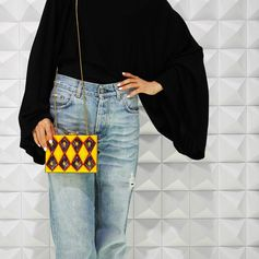 Clutch bag:Lolita Lorenzo Tops:Hermes by Martin Margiela Denim:Helmut Lang