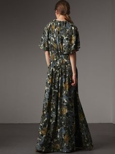 A floor-sweeping dress cut from swathes of silk, beautifully shaped with flared sleeves and a deep V-neckline. The soft silhouette is offset with artwork from the Burberry Beasts collection, and a front slit for movement. Add white trainers for all-day ease, switching to sandals as night falls.