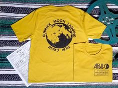 All Systems Go! Join the Stanley Kubrick Moon Landing Film Crew right in time for the 50th Anniversary of the Apollo 11 Mission. T Shirts available in Golden Mustard, Black, White, and Golden Mustard Long sleeve! Moon Landing Hoax Conspiracy Moon Room 237