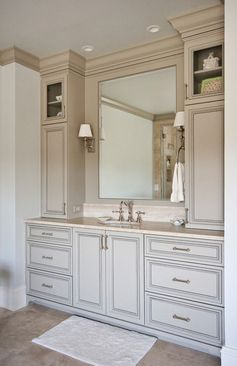 Like the storage on either side not necessarily the style. Vanity ideas for our ensuite. Don't know why the original builder put a tiny little sink in when there's a whole giant wall for storage! One day...