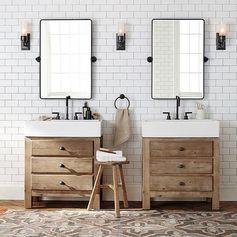 Salle de bains style industriel avec 2 meubles vasque séparés, miroirs en métal séparés. Carrelage métro avec joints noirs.