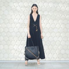 Chic simplicity lifted with a playful charm and Falabella chain detailing.   #StellaMcCartney #StellasWorld
