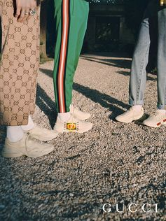 Designed with a thick sole and athletic construction, the new Gucci Rhyton sneaker has a retro influence with a distressed effect or embellished by the Gucci vintage logo prints from the 80s.
