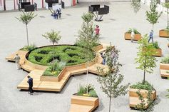 Mobile benches wrap around a circular garden.