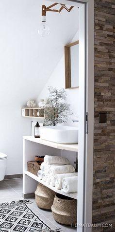 White rustic bathroom, wicker basket storage, botanical.