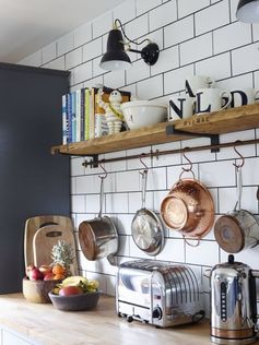 Like this shelf with the bar to hang underneath. Also like the look of the wooden shelf and metal bar
