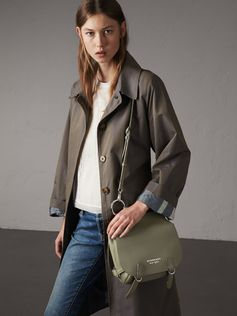 Our equestrian-inspired runway satchel in super-soft, grainy leather. Reflecting traditional British saddlery, the practical shape is crafted with utilitarian clasps, a grooved border and burnished edges. The Italian-made bag has a double-compartment construction to organise essentials, and can be worn with the long crossbody strap or leather shoulder strap.