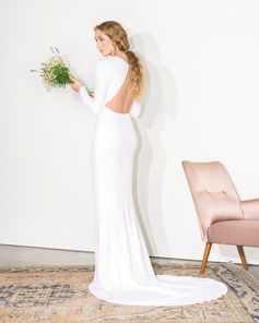 """Introducing our new bridal collection """"Made with Love"""", reimagining wedding dressing for the modern woman. Pictured is the Ruby: a statement-making gown with a structured shoulder and an exposed back."""