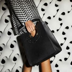 Structured elegance. The Gancini appears as a handle in a sleek linear tote. #MarieClaire #Ferragamo #FerragamoFolio