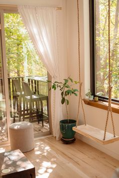 A swing beside a window inside a small house