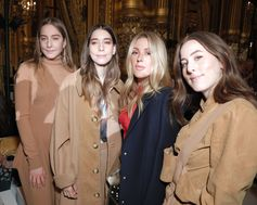Este, Danielle and Alana of HAIM and Ellie Goulding attend the Summer 2018 Stella McCartney runway show in Paris.