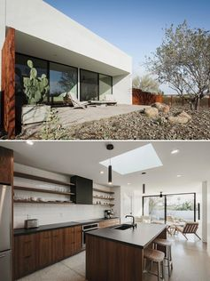 A modern guest house in the desert with an open plan living room and kitchen.