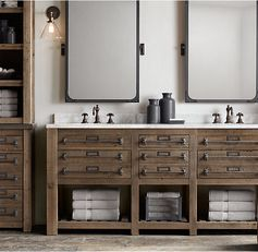RH's Early 20th C. Mercantile Double Vanity Sink:This collection is inspired by the rugged industrial character of fixtures salvaged from an early 20th-century mercantile shop. Crafted from reclaimed pine with a weathered finish that reveals the wood's rich history, the pieces boast stone tops to stand in refined contrast with the rustic wood.