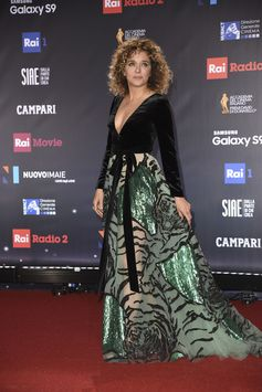 Valeria Golino shines bright tonight as she attended the 63rd David Di Donatello awards in Rome as best actress nominee for her role in the movie 'Il colore nascosto delle cose'. Valeria wears a #Valentino velvet and tulle gown with embroidered tiger motif especially designed for her by Pierpaolo Piccioli.