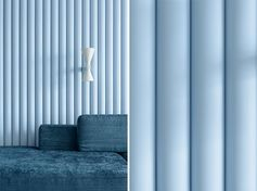 Designed as a way of adding texture to the room, this soft blue accent wall is made from panels that have ribbed finish, allowing the natural light to create ever-changing shadows on the wall. #SoftBlueInterior #BlueAccentWall #TexturedAccentWall #InteriorDesign #Blue #LivingRoom