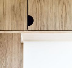 This hardware free oak cabinet has semi-circle cut-outs that allow for easy opening. #Cabinets #HardwareFreeCabinets