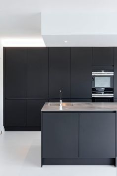 Love our matte black kitchen with stainless steel countertop on white pu floor