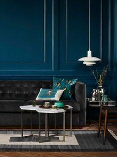 salon moderne design canapé cuir luminaire suspendu blanc tapis de sol