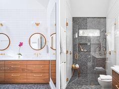 A modern bathroom with a wood vanity, gold accents, round mirrors, and grey hexagonal tiles in the shower and on the floor
