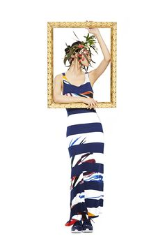 This dress is a square. Authentic, unique and original. Combines wide navy stripes with brightly colored 'handpaint'-inspired brushstrokes. Turns a long women's dress into a unique and authentic piece. Comfortable.