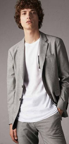 A tailored modern-fit blazer in an Italian-woven cotton wool blend with a micro houndstooth pattern. A notch lapel, check undercollar and buttoned cuffs add to the classic design. Wear with dark denim or tapered trousers for the evening.
