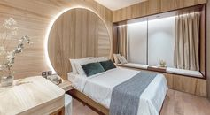 "Bedroom Idea - Using natural materials to create a sense of warmth and calm, the design of this circular headboard observes the Chinese concept of ""Earth's a square; heaven a circle"". It also has hidden lighting that creates a soft glow and outlines the design element. #BedroomIdeas #HeadboardIdeas #CircleHeadboard #CircularHeadboard #Lighting"