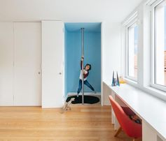 This modern kids room features a fire pole, which connects the bedroom with a lower floor play room, allowing the children (and adults), to have fun by sliding down the pole instead of using the stairs. #FirePole #FiremansPole #InteriorDesign #KidsBedroom