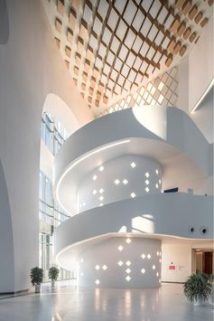 An oversized white spiral staircase with embedded lighting.
