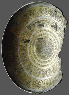 Cup with mythological scenes and flower of life pattern in the bottom visible in Louvre's museum (Department of Oriental Antiquities), originally from Idalion, Cyprus, 800–700BC
