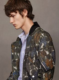 A lightweight bomber jacket emblazoned with artwork featuring creatures and thistles from the heraldic-inspired Burberry Beasts collection. The effortless layer is shaped with rib-knit trims, and finished with a military pen pocket at the sleeve in homage to classic flight jackets. Pair it with knitwear or a casual striped T-shirt as the weather dictates.