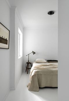 Using a small stool as a nightstand in the bedroom | Est Living