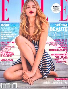 A Fendi striped beach dress on the cover of ELLE France, May 17.