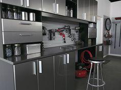 Contemporary Garage with Concrete floors, Built-in bookshelf, California Closets Custom Garage, High ceiling, French doors