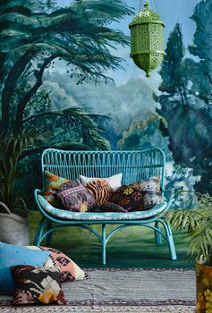 Look at that tree wallpaper! It is like a fairy forest! I love it! Boho home with a green lantern.