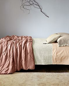 $598 Garnet Hill Eileen Fisher Seasonless Silk Comforter and Throw - Sand-washed silk is quilted into hand-stitched waves of texture. Quilt has extra-wide silk binding + mitered corners, 100% charmeuse silk. FILL? Backed with smooth cotton sateen, washed-silk front. Coordinating sham.
