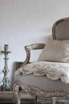 Simple, gray linen upholstery with an extra toile pillow. Perfection!
