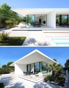 A minimalist white house with covered outdoor patios and glass walls.