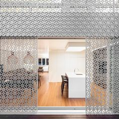 Sliding patterned screens add a decorative element to this house, as well act as a sunlight filter and a security screen
