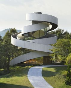 NAP Architects have designed the Ribbon Chapel, a wedding chapel in the gardens of 'Bella Vista Sakaigahama', a resort hotel in Onomichi, Hiroshima (Japan).