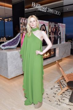 Elle Fanning was a vision in a green draped one-shoulder gown with neck tie from the Valentino Fall/Winter 2018-19 collection at the Hollywood Reporter and Jimmy Choo Power Stylists Dinner in Los Angeles.