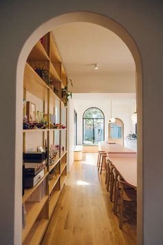 Doorway Ideas - An arched doorway off the dining area connects this contemporary house addition to the original house. #Doorway #ArchedDoorway