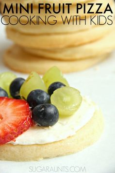 Make mini fruit pizzas with this cooking with kids recipe.  SO good and perfect or an after school snack or party treat!