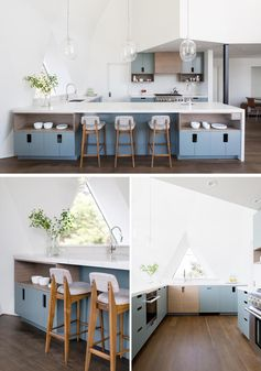 The open kitchen in this renovated geodesic dome house showcases custom cabinetry that consists of a mix of blue and bamboo slab fronts, with cutouts for handles. A quartz countertop and backsplash finish out the space and keep it bright. #ModernKitchen #BlueKitchenCabinets #QuartzCountertop #GeodesicDomeInterior