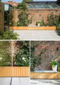 Oak clad planters extend along the garden wall and connect the building with the existing landscape. The old bricks provide a textured and warm backdrop to the new oak lining, flowers and greenery, while a small bench on top of the planter provides a place to appreciate the flowers and rest against the garden wall. #GardenIdeas #PlanterIdeas #GardenBench #ModernGarden